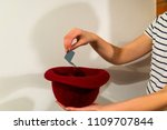 woman hand take a card with a... | Shutterstock . vector #1109707844