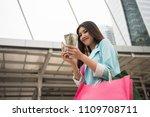 happy shopaholic asian girl... | Shutterstock . vector #1109708711