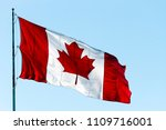 Canadian Flag Blowing In The...