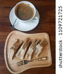 Small photo of Hot coffe abd tuna sandwish for breakfast