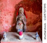 Small photo of Statue of a Monkey God wearing a Red Silk Shawl in Hoi An, Vietnam.