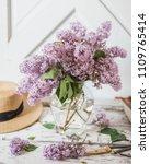 farmhouse lilacs in a vase | Shutterstock . vector #1109765414