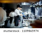 group of chef preparing food in ... | Shutterstock . vector #1109865974