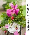 rosehip brunch in vase ... | Shutterstock . vector #110987105