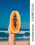 a slice of fresh papaya with... | Shutterstock . vector #1109872145