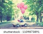 active little baby girl driving ... | Shutterstock . vector #1109873891