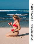 young woman in red bikini with... | Shutterstock . vector #1109875859