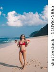 young woman in red bikini with... | Shutterstock . vector #1109875865