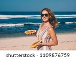 young woman with papaya on the... | Shutterstock . vector #1109876759