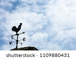 A weather vane  wind vane  or...
