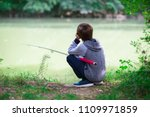 Young Fisher. Boy Fishing At...