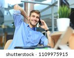 smiling businessman sitting and ... | Shutterstock . vector #1109975915