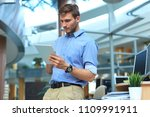 young man using his tablet in... | Shutterstock . vector #1109991911