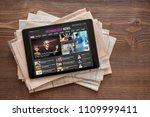 tech news website on tablet on... | Shutterstock . vector #1109999411