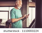 senior man on treadmill machine ... | Shutterstock . vector #1110003224