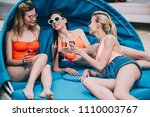 smiling young women in swimwear ... | Shutterstock . vector #1110003767