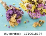 flowers on blue wooden table | Shutterstock . vector #1110018179