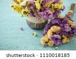bouquet of flowers on blue... | Shutterstock . vector #1110018185