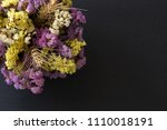 statice flowers on black stone... | Shutterstock . vector #1110018191