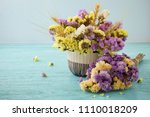 bouquet of flowers on blue... | Shutterstock . vector #1110018209