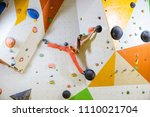 young woman climbing... | Shutterstock . vector #1110021704