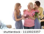 young woman with daughter... | Shutterstock . vector #1110023357