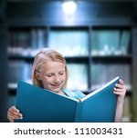 Little Girl Reading a Big Book in a Library - stock photo