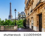cozy street with view of paris... | Shutterstock . vector #1110054404