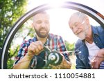 an adult hipster son and senior ... | Shutterstock . vector #1110054881
