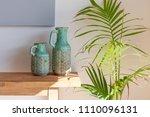 decorative vases on wooden...   Shutterstock . vector #1110096131