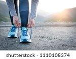 sport runner woman tying laces... | Shutterstock . vector #1110108374