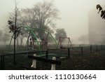 scary playground in the fog | Shutterstock . vector #1110130664