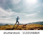 man runs with his beagle dog on ... | Shutterstock . vector #1110146864