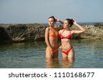 two woman in bikini standing in ... | Shutterstock . vector #1110168677