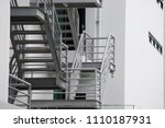 grey fire exit stair outside of ... | Shutterstock . vector #1110187931