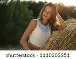 young woman by the sunset in... | Shutterstock . vector #1110203351