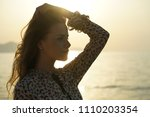 close portrait of sad woman by... | Shutterstock . vector #1110203354