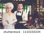 portrait of frendly waiter and... | Shutterstock . vector #1110233234