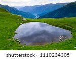 small mountain lake in the...   Shutterstock . vector #1110234305