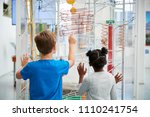 two kids looking at a science... | Shutterstock . vector #1110241754