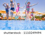 children play in  pool at the... | Shutterstock . vector #1110249494