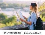 young female traveler standing... | Shutterstock . vector #1110263624