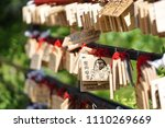 Small photo of Kawaguchiko, Japan - May 14, 2018 : A photo of Wishing wood tags hanging on Japanese small shrine, Usagi Shrine (meaning rabbit temple). At the back of the wooden tag, worshipers can write down wishes