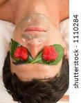 a man enjoys a fruit acid peel | Shutterstock . vector #1110284