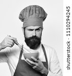 cook is cooking. man with beard ... | Shutterstock . vector #1110294245