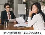 uptight asian woman expressing... | Shutterstock . vector #1110306551