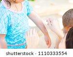 mother applying sunscreen... | Shutterstock . vector #1110333554
