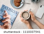 young woman with cup of... | Shutterstock . vector #1110337541