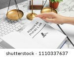 woman turning page of book with ... | Shutterstock . vector #1110337637