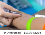 nurse collecting a blood from... | Shutterstock . vector #1110343295